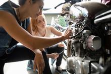 Young Women Friends Repairing ...