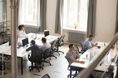 Fototapeta Diverse employees busy working together in shared office obraz