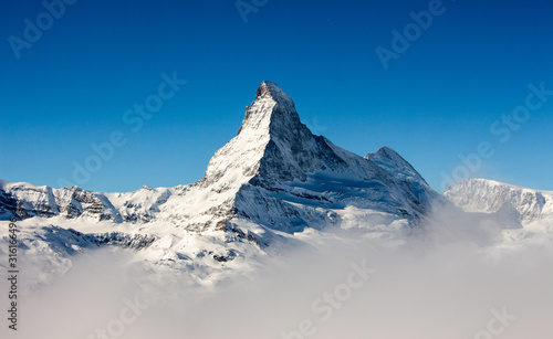 Photo Zermatt Matterhorn view mountain winter snow landscape sea of fog clouds sunset