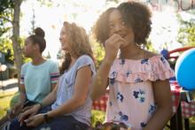 Girl Eating Fresh, Ripe Cherries At Summer Neighborhood Block Party In Park