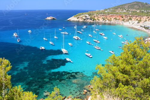 Cala d'Hort bay with beach and turquoise water on Ibiza