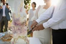 Senior Bride And Groom Cutting...