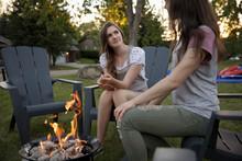 Teenage Girls Enjoying Fire Pi...