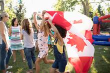 Girls Waving Canadian Flag On ...