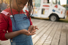 Cute Girl Counting Coins Outside Ice Cream Truck