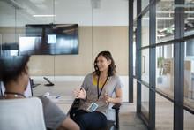 Smiling Businesswoman Talking ...