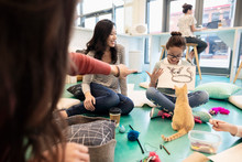 Girl Drawing Kitten In Cat Cafe