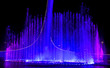 canvas print picture - A dancing fountain of blue in the park