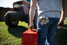 Male Farmer Carrying Toolbox T...