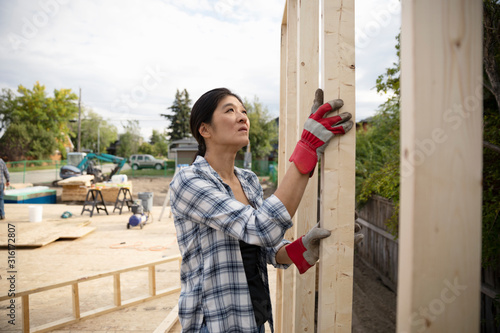 Canvas Print Woman working at construction site