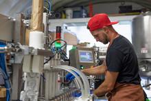 Man Working In Beer Distillery