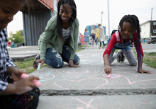 Mother And Daughters Coloring With Sidewalk Chalk