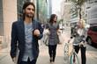 Business people walking on city sidewalk