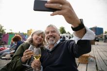 Happy Senior Couple Drinking W...