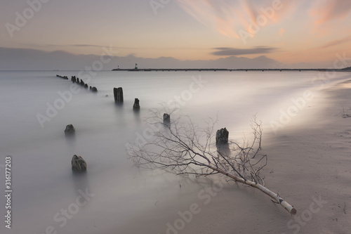 Soft waterscape with stick on foreground, made on long exposure shutter Tableau sur Toile