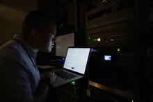IT Technician Using Laptop In ...