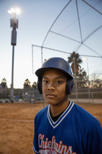 Portrait Confident, Determined Baseball Player On Field At Night