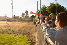 Fan With Vuvuzela Horn Watchin...
