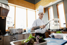 Female Chef With Tattoos Sharp...