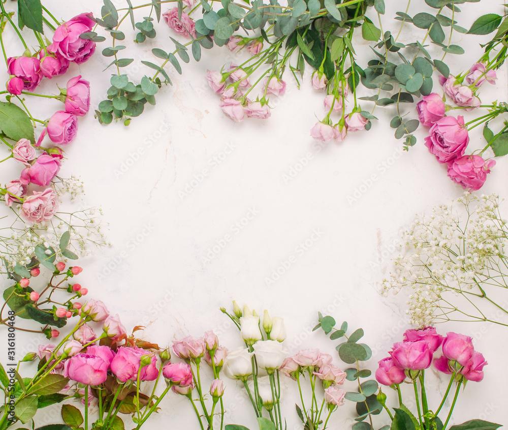 Fototapeta Frame of flowers on white marble background