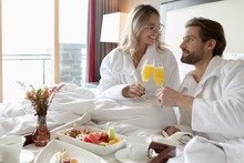 Couple In Bathrobes Drinking M...