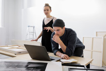 Art Gallery Owners Working At Laptop