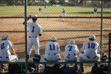 Baseball Players Watching Game From Bench