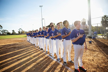 Baseball Players Standing In A Row For National Anthem
