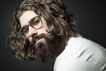 Portrait Confident Handsome Young Man With Curly Long Hair And Beard