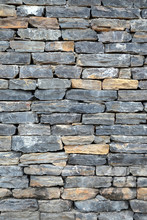 Wall Stonework Finishing From Colorful Natural Stone Trim As Background Front View Vertical Close Up