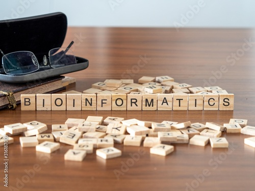 Photo bioinformatics concept represented by wooden letter tiles