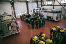 Firefighters Meeting In Fire Station
