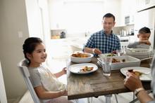 Family Enjoying Dinner At Table