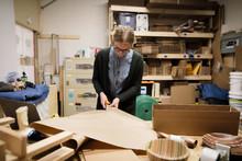 Female Artist Cutting Craft Pa...