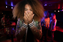 Portrait Laughing Young Woman In Nightclub