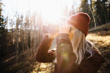 Woman With Binoculars Hiking, Bird Watching In Sunny Woods