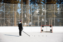 Woman Playing Outdoor Ice Hock...