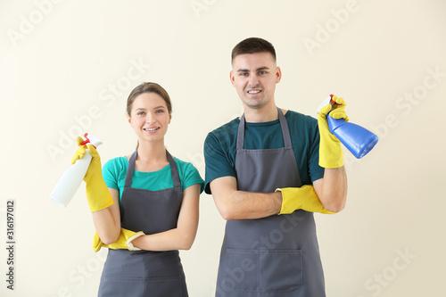 Cuadros en Lienzo  Portrait of janitors on light background