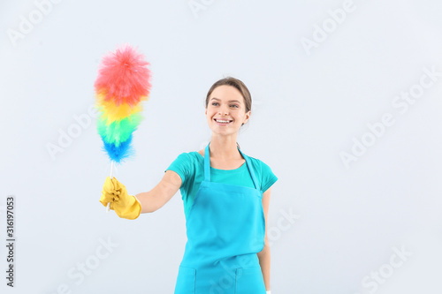 Fotomural  Portrait of janitor on light background