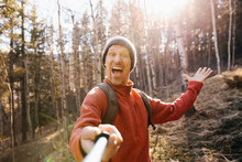 Point Of View Man Hiking, Taking Selfie With Selfie Stick In Sunny Woods