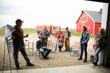 Farmers Meeting In Barn Doorway