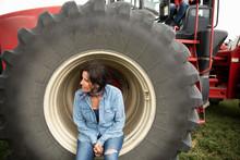 Female Farmer Resting Against ...