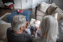 Senior Couple Video Chatting W...