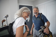 Happy Senior Couple With Golf ...