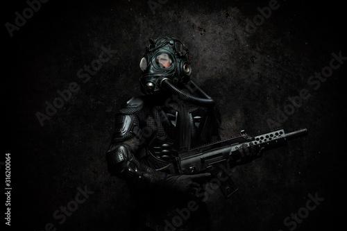 Leinwand Poster Futuristic warrior a machine gun in his hands