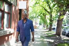 Businessman Walking On Urban S...