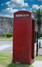 An Old Fashioned Red Telephone Booth In A Public Park