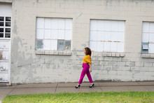 Woman In Vibrant Clothing Walk...