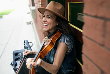 Happy Woman Playing Violin On ...