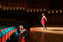 Female Dancer Performing For Judges On Stage In Auditorium